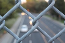 Chain link fence with highway in background